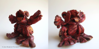 "7. Red Frog (Storyteller Series), clay/oil paint, 7"" x 3"" x 4"", $150"