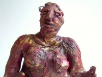 """Gold and Red Woman, clay with oil, 7"""" x 10.5"""" x 7.5"""""""